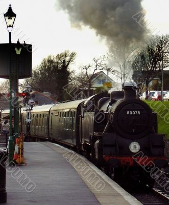 Heritage steam train coming into station