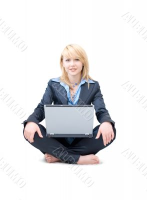 Shoeless businesswoman with laptop do meditative exercises
