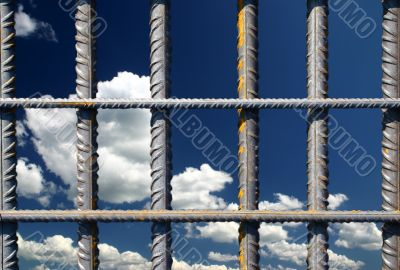 Iron bars on a blue sky