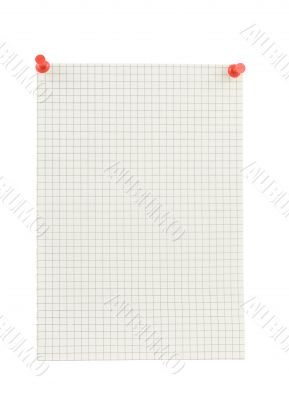 piece of squared paper thumbthacked to white wall