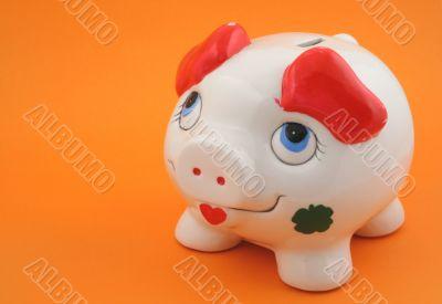 piggy bank on orange
