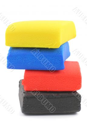 pile of colorful plasticine blocks on white
