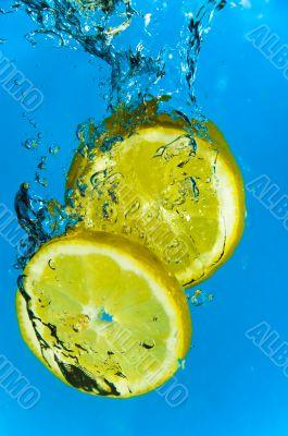 Lemon Fruit Splashing into Citrus Water