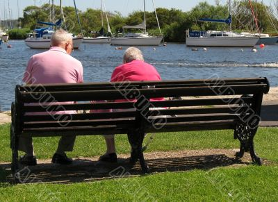 two friends relaxing at waters edge