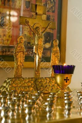 Jesus Christ`s crucifixion. A burning candle.