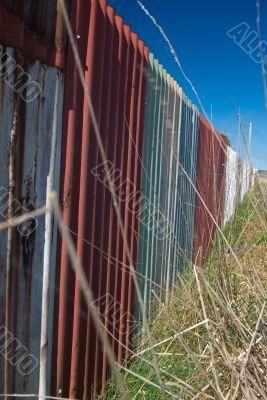 Dilapidated Roadside Corrugated Iron Fence