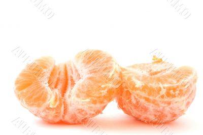 peeled tangerines on white
