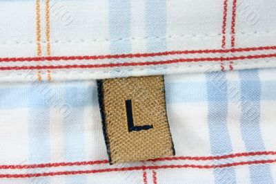 real macro of clothing label - SIZE L