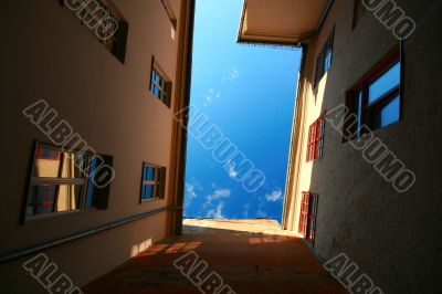 House wall with windows, reflections, shadows