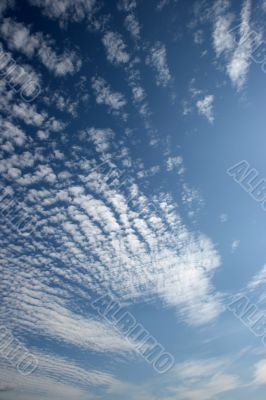 Panorama of blue white cloudy sky wide angle view
