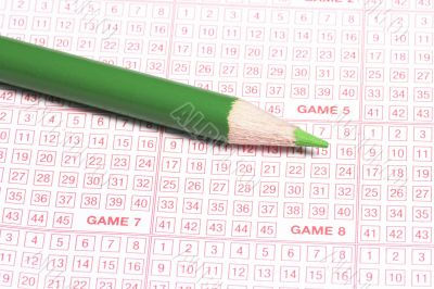 Lottery Ticket And Green Pencil