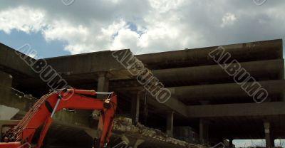 Machine demolishes building