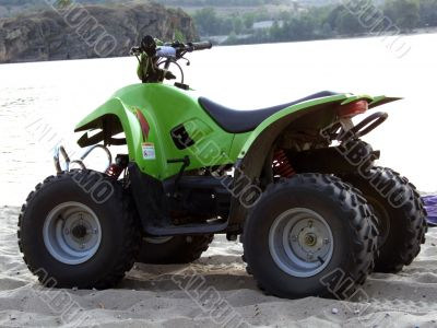 Small All Terrain Vehicle on coast of the river