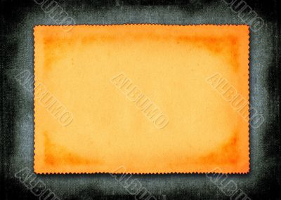 piece of yellowed paper against material background