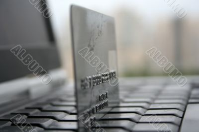 A shot of a laptop and a credit card