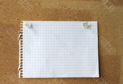 empty sheet on a corkboard