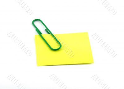 A paper clip and sticker.
