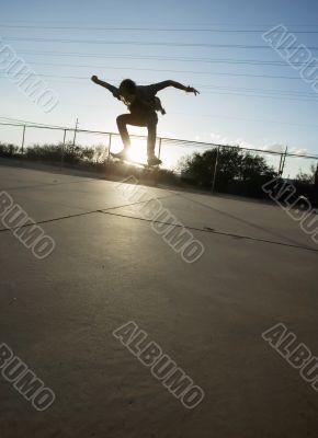 Teenage Skateboarder Airborne