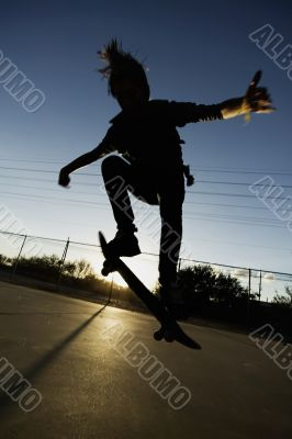 Teenage Skateboarder at Sunset