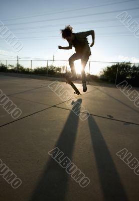 Teenage Skateboarder Doing Trick