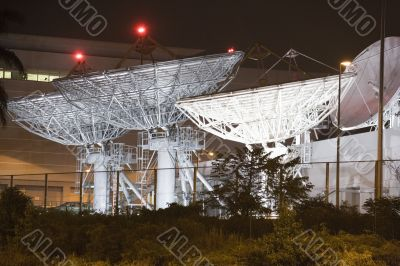 Satellite Communication Dishes at Night