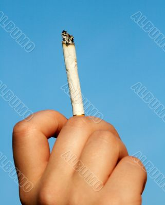cigarette end in woman hand