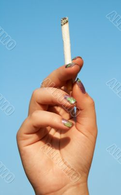 woman hand with cigarette