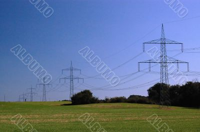 blue sky on grass and transmission facilities