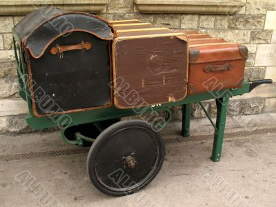 old style luggage on trolley