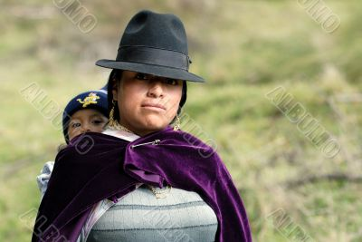 latin woman in national clothes with little child