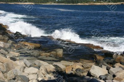 Breaking waves on granite ledges
