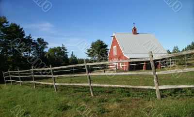 New England red barn and fence