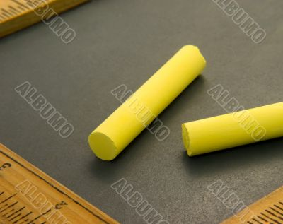 Yellow Chalk on Writing Slate