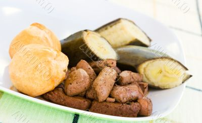 Liver, fried dumplings and banana