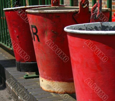 Row of red fire buckets
