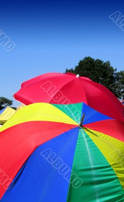 Colourful summer umbrellas as sunshades