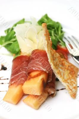 Procuitto ham rolled around fresh melon