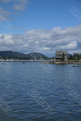 New England house & pier in harbor