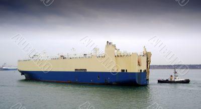 cargo ship and tug