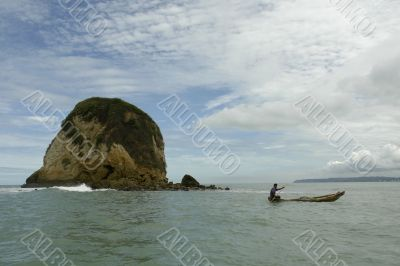 the latin man in boat on pacific