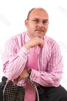 Handsome businessman leaning on squashracket