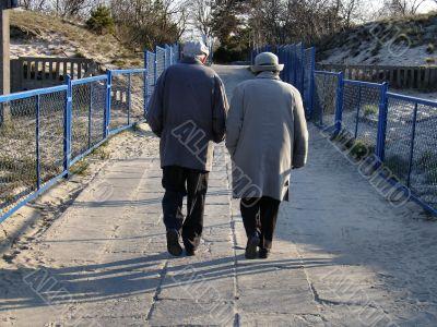 elderly couple on a walk