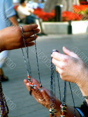 Closeup of Hands Holding Jewelry