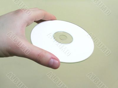 hand holding a blank cd
