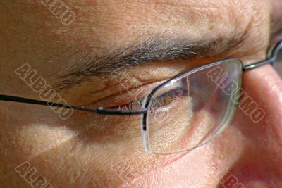 close up of eye and glasses