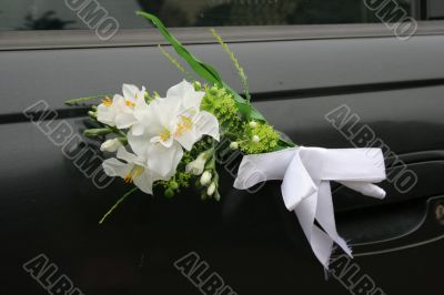 Wedding car decorations with flower bouquet
