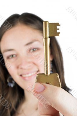 beautiful girl holding key of success