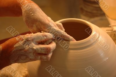 Potter`s hands creating new ceramic vase