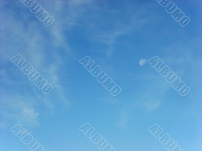 day skies with white moon and clouds