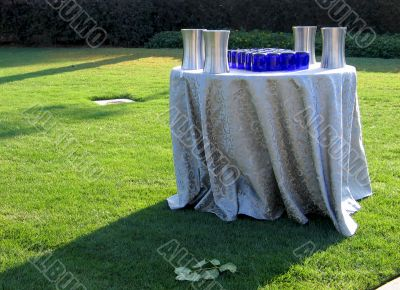 Table with tablecloth and glasses